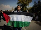 TEHRAN, Dec. 8, 2017 - A man holds a flag of Palestine during a protest in Tehran, Iran, on Dec. 8, 2017. Tens of thousands of Iranians held a nationwide rally on Friday to condemn the U.S. President ...