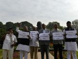Telugu Desam Party MPs stage a demonstration at Mahatma Gandhi statue in Parliament urging the centre to take steps to fulfil bifurcation promises and pending issues for AndhraPradesh, in ...