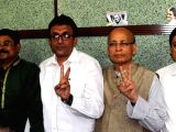 TMC leaders Subhasish Chakraborty, Abir Biswas, Santanu Sen and Nadimul Haque along with Congress leader Abhishek Manu Singhvi show victory sign after filing their nomination papers for the ...