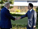 TOKYO, Nov. 5, 2017 - U.S. President Donald Trump (L) shakes hands with Japanese Prime Minister Shinzo Abe upon his arrival at the Kasumigaseki Country Club in Kawagoe, near Tokyo, Japan, Nov. 5, ...