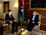TRIPOLI, Feb. 19, 2018 - Charge d'affaires of the Chinese Embassy to Libya Wang Qimin (L) meets with the Head of the Libyan High Council of State Abdurrahman Swehli in Tripoli, Libya, on Feb. 19, ...