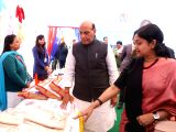 Union Home Minister Rajnath Singh visits the stalls put up by the Police Families Welfare Society, Delhi during the 71st Raising Day Parade of Delhi Police, in New Delhi on Feb 16, 2018.