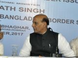 Union Home Minister Rajnath Singh with West Bengal Chief Minister Mamata Banerjee and Assam Chief Minister Sarbananda Sonowal during a meeting of states having international border at Nabanna ...