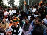 Union Minister and BJP leader Arjun Ram Meghwal along with other party workers participates in a silent protest after a BJP youth wing's motorcycle rally to mark the birth anniversary of ...