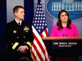 WASHINGTON, Jan. 16, 2018 - White House press secretary Sarah Huckabee Sanders (R) introduces White House physician, Navy doctor Ronny Jackson, during a press briefing at the White House in ...