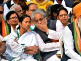 West Bengal Chief Minister Mamata Banerjee in a conversation with Trinamool Congress (TMC) MP Sudip Bandyopadhyay during a rally to observe Dr. B R Ambedkars 61st death anniversary in ...