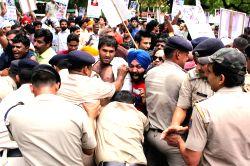 Aam Admi Party activists demonstrate against BJP leaders Vashundhara Raje Scindia, Sushma Swaraj, Smriti Irani and Pankaja Munde in New Delhi on June 29, 2015.