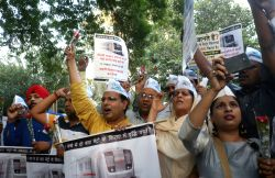 AAP workers stage a demonstration outside Union Science and Technology Minister Harsh Vardhan's residence against hike in metro  fares in New Delhi, on Oct 14, 2017.