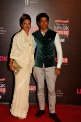 Actor Farhan Akhtar with his wife Adhuna during the 20th Annual Life OK Screen Awards in Mumbai, on January 14, 2014.