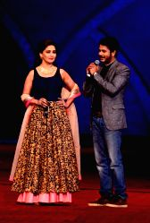 Actor Jay Soni attempts to woo actress Madhuri Dixit during COLORS Golden Petal Awards 2013 in Mumbai on Dec.14, 2013.