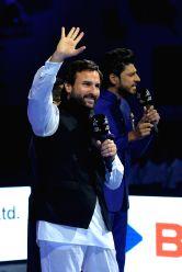Actors Abhishek Bachchan and Saif Ali Khan cheer during a Pro Kabaddi League match between Jaipur Pink Panthers and Gujarat Fortunegiants at Sawai Mansingh Stadium in Jaipur on Oct 6, 2017. ...