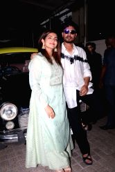 Actors Irrfan Khan and Parvathy arrive at the trailer launch of their upcoming film