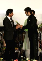 Actors Shahrukh Khan and Jeet during inauguration of 19th Kolkata International Film Festival in Kolkata on Nov.10, 2013.