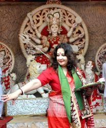 Actress and Trinamool Congress MP Moon Moon Sen participates in Sindoor Khela at Chalta Bagan Durga Puja pandal in Kolkata on Oct 3, 2017.