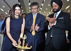 Actress Prachi Desai, Maruti Suzuki India Ltd. Executive Director (Marketing and Sales) Hashimoto, Executive Director (Marketing and Sales) RS Kalsi during the inauguration of 'Maruti Suzuki ...