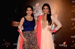 Actresses Madhuri Dixit and Huma Qureshi during COLORS Golden Petal Awards 2013 in Mumbai on Dec.14, 2013.