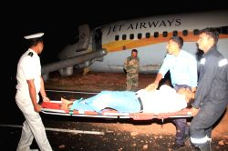 Airport Authority officials evacuate one of the passengers from Jet Airways Goa-Mumbai (9W 2374) flight that skidded off the runway during take-off, injuring 15 passengers onboard at Dabolim ...