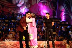 Ali Asgar (Dadi) kisses Karan Johar during COLORS Golden Petal Awards 2013 in Mumbai on Dec.14, 2013.