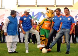 All India Football Federation (AIFF) president Praful Patel with actor Hrithik Roshan and former footballer Bhaichung Bhutia during Mission XI Million festival in Ahmedabad on April 8, ...