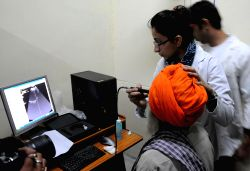 A man who lost his vision after undergoing eye surgery at an eye camp organised by an NGO in Gurdaspur district of Punjab being treated at an Amritsar Hospital on Dec 5, 2014. At least 15 ..