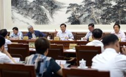 BEIJING, June 29, 2016 - Zhang Dejiang (C, back), chairman of the Standing Committee of China's National People's Congress (NPC), attends a group deliberation of the draft of Law on the Red Cross ...