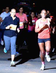 Bengaluru: People participate in SBI Bengaluru Midnight Marathon at ITPL in Bengaluru on Dec 21, 2014.
