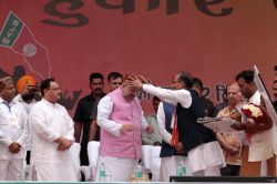 BJP chief Amit Shah honoured by party's Himachal Pradesh president Satpal Singh Satti during the