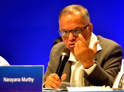 :Chairman of Infosys NR Narayana Murthy addressing his last speech in the 33rd Annual general meeting of Infosys, at Christ University in Bangalore on June 14, 2014. (Photo: IANS).
