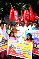 Chennai: Members of Communist Party of India shout slogans against a visit of U.S. President Barack Obama to India, in Chennai, India, on Jan. 24. 2015.