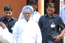 Congress leader and former Prime Minister Dr Manmohan Singh comes out after casting his vote during the second phase of Assam Legislative Assembly polls in Guwahati, on April 11, 2016.