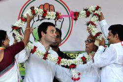 Congress vice president Rahul Gandhi and CPI-M leader Buddhadeb Bhattacharya during a Congress-Left alliance rally in Kolkata on April 27, 2016.