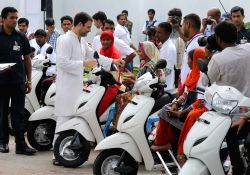 Congress vice president Rahul Gandhi distributes scooties to differently abled persons on the occassion of former Prime Minister late Rajiv Gandhi's birth anniversary in New Delhi on Aug ...