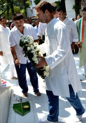 Congress vice president Rahul Gandhi pays floral tribute to martyr Swahid Kushal Konwar after appearing in CJM Court in connection with defamation case filed by RSS in Guwahati on Sept 29, ...