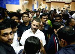 Congress Vice President Rahul Gandhi queue up at the State Bank of India's Parliament street branch in New Delhi on Nov. 11, 2016.