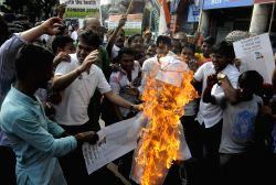 Congress workers shout slogans against Kolkata Mayor Sovan Chatterjee during a protest in front of Kolkata Municipal Corporation headquarters in Kolkata on Sep 3, 2015.