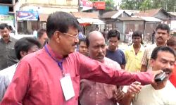 Cooch Behar: Trinamool Congress candidate from Natabari constituency in Cooch Behar district of West Bengal Rabindranath Ghosh assaults one of his party workers during the sixth and final phase of ...