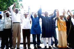 CPI-M General Secretary Sitaram Yechury and CPI leader D Raja during Dalit Swabhiman Sangharsh Rally at Jantar Mantar in New Delhi on Sept 16, 2016.