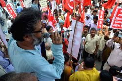 CPI (M-L) Liberation general secretary Dipankar Bhattacharya addresses during Bihar bandh called by leftist organisations in Patna, on July 21, 2015.