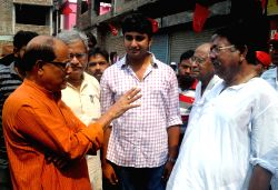 CPI-M leaders Satarup Ghosh and Ashok Bhattacharya participate in a Left-Congress alliance rally in Kolkata, on April 28, 2016.