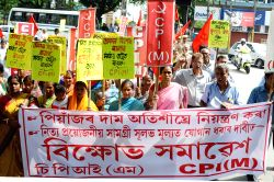CPI-M workers participate in a demonstration against hike in onion prices in Guwahati, on Aug 27, 2015.