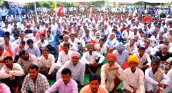 CPI (M) workers stage a demonstration against various issues including hike in electricity tariffs, land acquisition ordinance in Jaipur, on March 23, 2015.