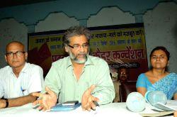 CPI-ML general secretary Dipankar Bhattacharya addresses a press conference in Patna on Aug 24, 2016. (Photo: IANS)