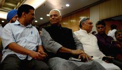 Delhi Chief Minister Arvind Kejriwal and BJP leader Yashwant Sinha at the release of Congress leader Manish Tewari's book