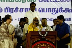 DMK chief M Karunanidhi addresses during an election rally ahead of Tamil Nadu Legislative Assembly elections in Chennai on May 5, 2016. Also seen Congress President Sonia Gandhi.