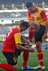 East Bengal striker Rabin Singh poses to clean shoe of fellow player Andrew Nikolas Barisic after his scorring goal during East Bengal vs MD. Sporting Club in Kolkata League match.  East Bengal won the match 6-1 at Vivekananda Yuba Bharati Krirangan in Kolkata on Feb. 23, 2013 .(Photo: Kuntal Chakrabarty/IANS)
