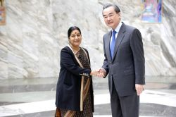 External Affairs Minister Sushma Swaraj meets Wang Yi, Foreign Minister of China in Moscow on April 18, 2016.