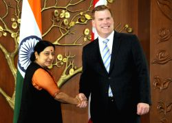 External Affairs Minister Sushma Swaraj shakes hands with her Canadian counterpart John Baird during a meeting in New Delhi, on Oct.14, 2014.