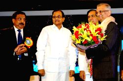 Finance Minister,  P.Chidambaram  felicitated Dr. Anil Kakodkar (eminent nuclear scientist and Chairman, Research Advisory Council, JNNSM at Department of Atomic Energy); at Platinum Jubilee Celebration function of Dena Bank in Mumbai on Saturday 25 May 2013.