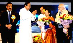 Finance Minister, P.Chidambaram  felicitated Smt. Jyoti Sanghvi and Shri Nirmal Nanjee from the founder s family at Platinum Jubilee Celebration function of Dena Bank in Mumbai on Saturday 25 May 2013.