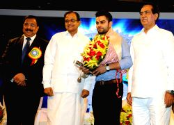 Finance Minister, P.Chidambaram felicitated Virat Kohli (eminent cricketer coached by Dena Bank employee Rajkumar Sharma); at Platinum Jubilee Celebration function of Dena Bank in Mumbai on Saturday 25 May 2013.